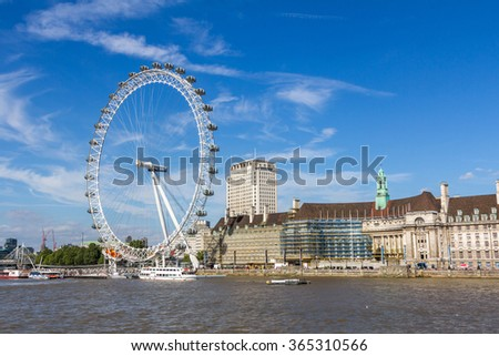 LONDON, UK - JULY 22, 2015: London Eye is a giant Ferris wheel on the South Bank of the River Thames in London.  - stock photo