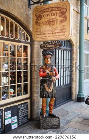 LONDON, UK - 22 JULY, 2014: Old Pub in Covent Garden market, one of the main tourist attractions in London, known as restaurants, pubs, market stalls, shops and public entertaining. - stock photo