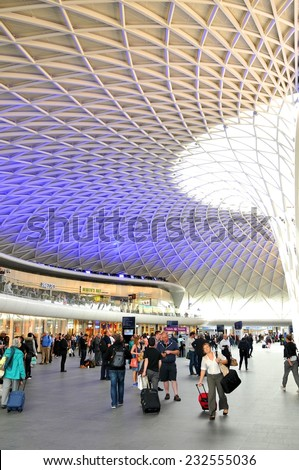LONDON, UK - JULY 9, 2014: People transit the King's Cross train station in central London. - stock photo
