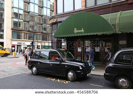 LONDON, UK - JULY 9, 2016: People visit Harrods department store in London. The famous retail establishment is located on Brompton Road in Knightsbridge district. - stock photo