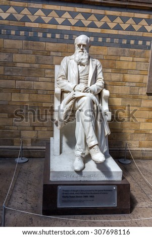 LONDON, UK - JULY 20, 2015: Statue of Charles Darwin by Sir Joseph Boehm in the main hall of the Natural History Museum in London. He was best known for his contributions to evolutionary theory. - stock photo