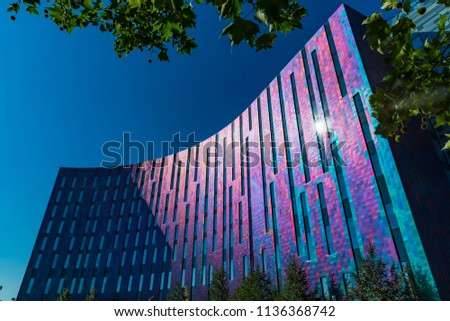 London, UK - JULY 15 2018: The ExCeL Center, an exhibitions and international convention centre Bright and colourful facade of the Aloft Hotel