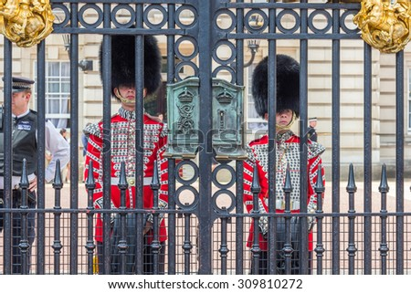 LONDON, UK - JULY 21, 2015: The Queen's Guard at Buckingham Palace in London, UK. They are called King's Guard and King's Life Guard when the reigning monarch is male. - stock photo