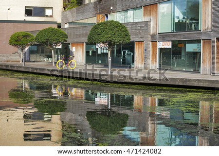London, UK - July 17, 2016. The Regent's Canal runs through an area of ongoing regeneration with new apartment buildings