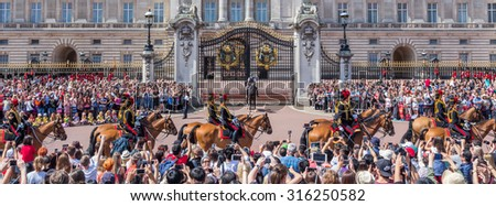 LONDON, UK - JULY 22, 2015: Traditional Changing of the Guards ceremony near Buckingham Palace. This ceremony is one of the most popular tourist attractions in London. - stock photo