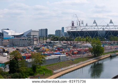 LONDON, UK-JULY 31: View of the Olympic Park, Stadium and Aquatic Centre,from Hackney Wick.The Olympic park is under construction for the London 2012 Olympic Games,  July 31, 2011 in London UK - stock photo