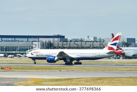LONDON, UK - JUN 17, 2015: A British Airways airplane taxis on a runway at Heathrow Airport. Heathrow is one of the world's busiest airports handling 73.4 million passengers in 2014. - stock photo
