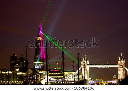 LONDON, UK - JUNE 05: A laser and light show is shown from the Shard to announce the opening of the tallest building in Europe on the June 05, 2012 in London, UK - stock photo