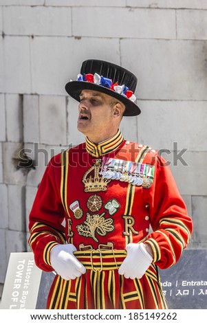 LONDON, UK - JUNE 03, 2013: Beefeaters (Yeomen Warders of Fortress Tower of London) in Tudor State Dress on occasion of celebrating 60 anniversary of Coronation of Queen Elizabeth II, in London - stock photo