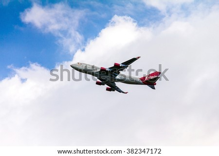 LONDON, UK - JUNE 5, 2015:  Boeing 747 Virgin Atlantic gaining altitude after takeoff  from  London's Heathrow airport. Plane is wearing new livery announced in early 2011.