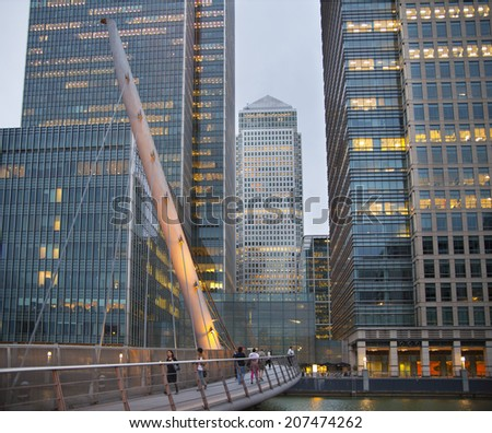 LONDON, UK - JUNE 14, 2014: Canary Wharf at dusk, Famous skyscrapers of London's financial district at twilight.