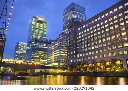 LONDON, UK - JUNE 14, 2014: Canary Wharf at dusk, Famous skyscrapers of London's financial district at twilight. - stock photo
