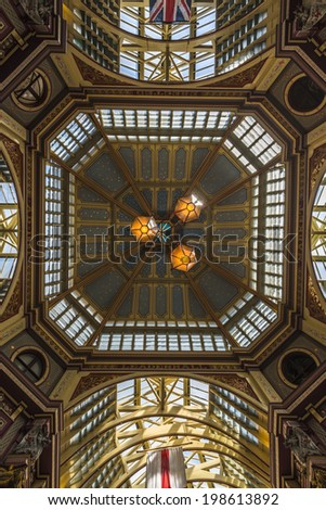 LONDON, UK - JUNE 08, 2014: Inside view of Leadenhall Market, Gracechurch Street. The building was designed at the end of the 19h century by Sir Horace Jones and  renovated In the early of 1990s - stock photo