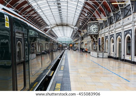 London, UK - June 19, 2016: London Paddington station with unidentified people. Much of the main-line station dates from 1854 and was designed by Isambard Kingdom Brunel