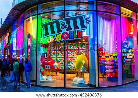 London, UK - June 19, 2016: M&M store with unidentified people. M&Ms originated in US in 1941, now sold in as many as 100 countries. More than 400 mio individual M&M's are produced every day in the US