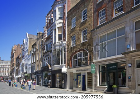LONDON, UK - JUNE 3, 2014: Mayfair town houses and shops, center of London - stock photo