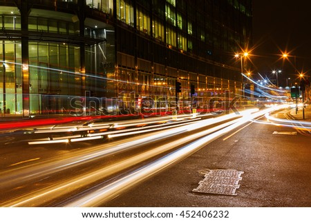 London, UK - June 19, 2016: night traffic on the Bishopsgate road in the City of London. The City of London is the a major business and financial center