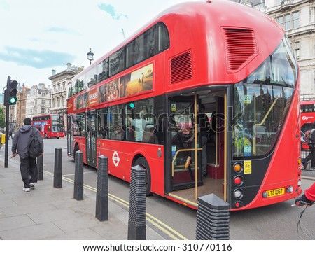 LONDON, UK - JUNE 09, 2015: Red double decker buses are a traditional landmark of London - stock photo