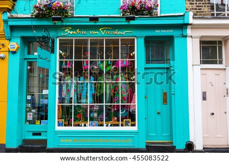 London, UK - June 19, 2016: shop with exotic fashion in a beautiful old building at Portobello Road. Portobello road is a tourist attraction for its street market with second hand clothes and antiques - stock photo