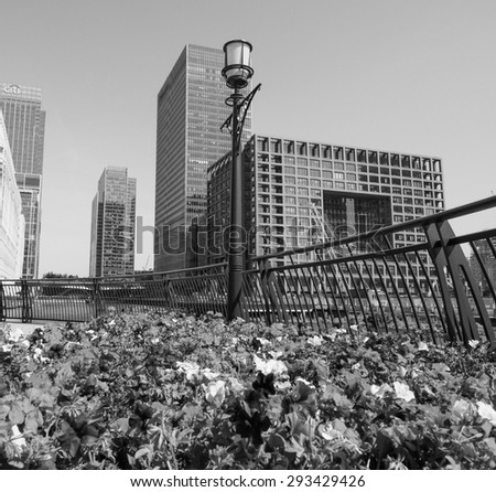 LONDON, UK - JUNE 11, 2015: The Canary Wharf business centre is the largest business district in the United Kingdom in black and white