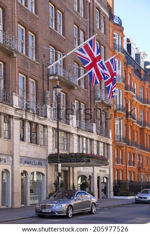LONDON, UK - JUNE 3, 2014: The Claridges hotel, main entrance with nationals flags