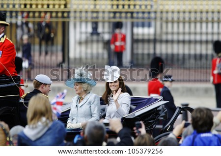 LONDON, UK - JUNE 16: The Duchess of Cambridge, the Duchess of Cornwall and Prince Harry during Trooping the Colour ceremony, on June 16, 2012 in London. - stock photo