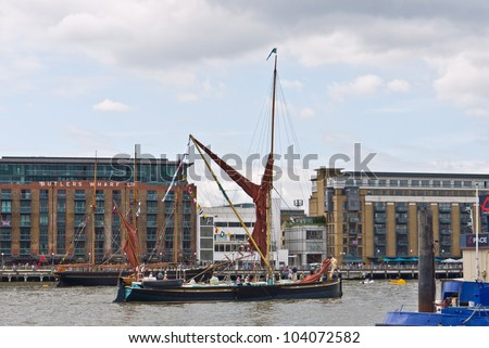 LONDON, UK-JUNE 1: The Edith May a traditional sailing barge, built in 1906 sails up the Thames past Butlers Wharf to take part in the Queen's Diamond Jubilee Pageant. June 1, 2012 in London UK. - stock photo