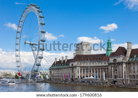 London, UK - June 7, 2009: The London Eye is a Ferris wheel situated on the south bank of the Thames in London. Its construction began in 1998 and ended March 9, 2000. The elevation is 135 meters.