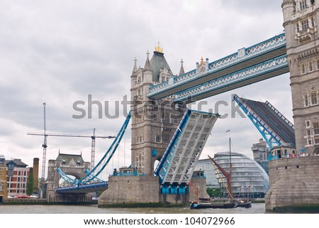 LONDON,UK-JUNE 1: The May a sprit sail barge built in 1891 sails under the raised Tower Bridge to take part in the Queen's diamond Jubilee Pageant on the Thames. June 1, 2012 in London UK. - stock photo