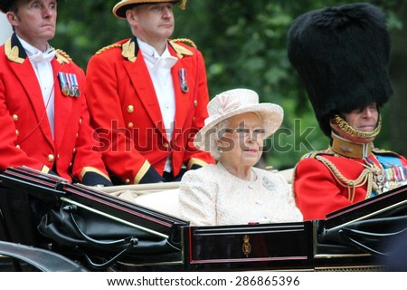 LONDON, UK - JUNE 13: The Queen Elizabeth and Prince Phillip appear during Trooping the Colour ceremony, on June 13, 2015 in London, England, UK - stock photo