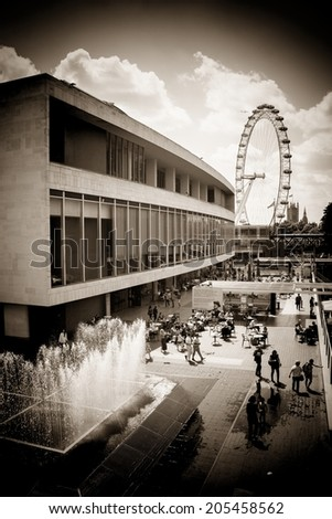 LONDON, UK - JUNE 21 2014: The Southbank Centre, with Millennium Wheel and Westminster in the distance, London. - stock photo