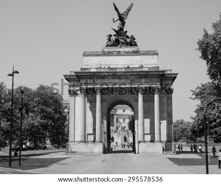 LONDON, UK - JUNE 11, 2015: Tourists visiting the Wellington arch in black and white - stock photo