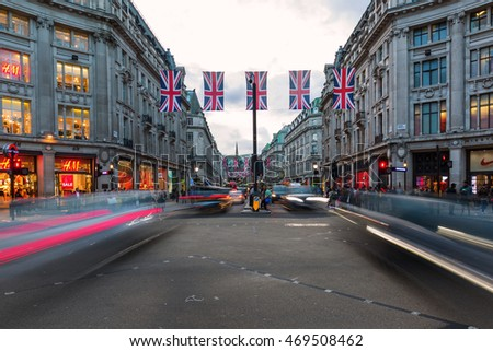 London, UK - June 16, 2016: traffic at Oxford Circus at dusk, with unidentified people. Up to over 40.000 pedestrians per hour pass the junction, its the highest pedestrian volumes recorded in London