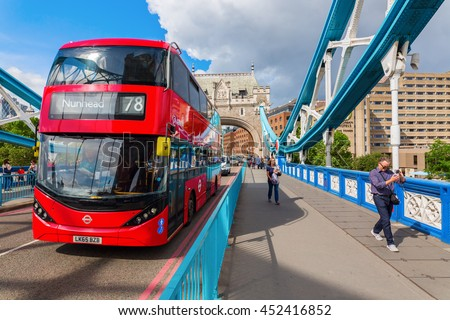 London, UK - June 15, 2016: traffic on Tower Bridge in London with unidentified people. The bridge spanning the river Thames is a combined bascule and suspension bridge in London built in 1886 - 1894 - stock photo