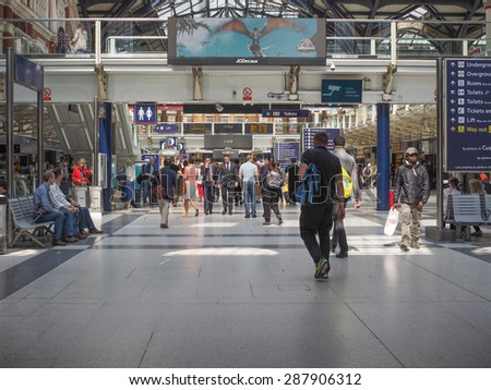 LONDON, UK - JUNE 12, 2015: Travellers at Liverpool Street Station - stock photo
