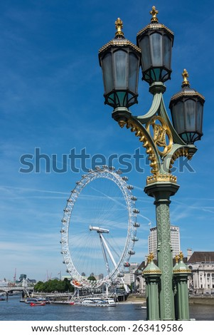LONDON, UK - June 6, 2014 : View from Westminster Bridge including the River Thames and London Eye big wheel in central London, a very popular tourist attraction with stunning views of the capital. - stock photo