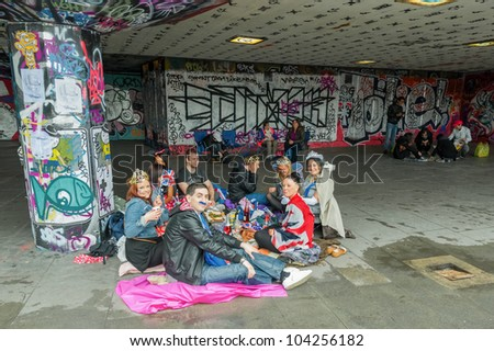 LONDON, UK - JUNE 3:  Youth enjoying a picnic amongst the urban art on the South Bank during the Queen Elizabeth II Diamond Jubilee celebrations in London, UK on June 3, 2012 - stock photo