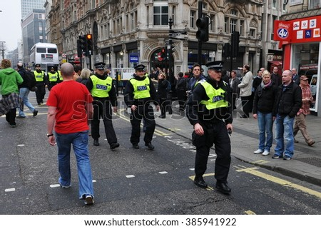 LONDON, UK - MAR 26, 2011: Riot police deploy in the city center after violent riots break out during a 250,000 strong TUC organised anti public sector spending cuts rally.