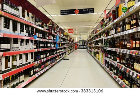 LONDON, UK - MAR 7, 2015: View of an empty aisle at the alcoholic beverages section of a Sainsbury's supermarket. Sainsbury's is the UK's 2nd largest supermarket with a revenue of £23 billion in 2013. - stock photo