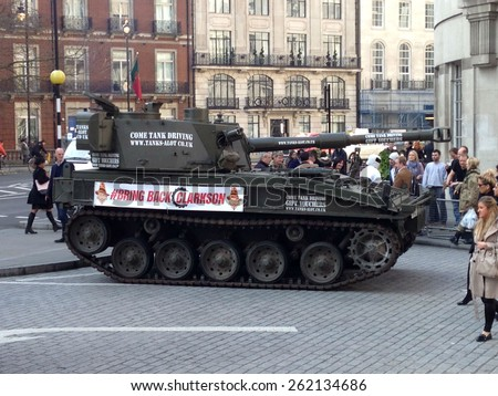 LONDON, UK - MARCH 20, 2015:  A tank driven by The Stig delivering a petition to the BBC in support of Jeremy Clarkson.  The presenter has been suspended from Top Gear after a fracas with a producer.