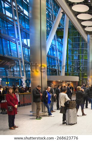 LONDON, UK - MARCH 28, 2015: Heathrow airport Terminal 5. People waiting for arrivals - stock photo