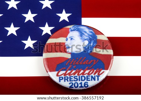 LONDON, UK - MARCH 3RD 2016: A Hillary Clinton 2016 pin badge over the US flag symbolizing her campaign to become the next President of the United States, 3rd March 2016. - stock photo