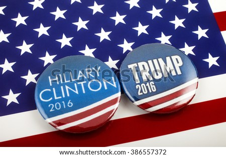 LONDON, UK - MARCH 3RD 2016: Hillary Clinton and Donald Trump pin badges over the American flag, symbolizing their battle to become the next President of the United States, 3rd March 2016.   - stock photo