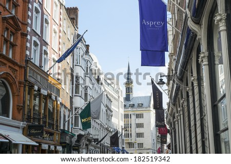 LONDON, UK - MARCH 01: Row of of banners for famous and expensive shops in New Bond Street. March 01, 2014 in London. - stock photo