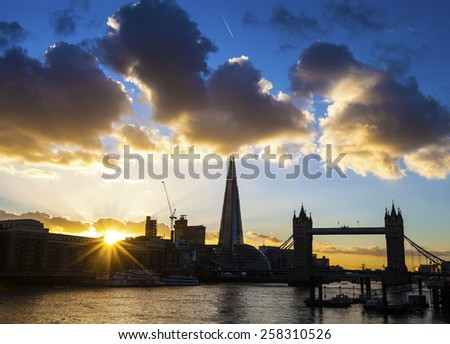LONDON, UK - MARCH 4TH 2015: A dusk-time view of London silhouetting famous landmarks including Tower Bridge and the Shard on the 4th March 2015. - stock photo