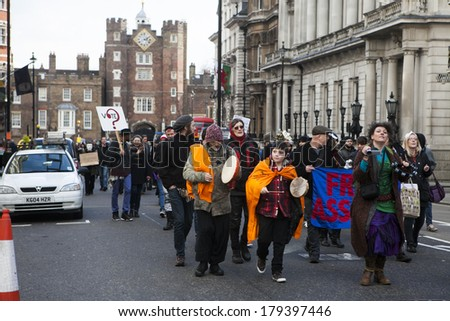 LONDON, UK - MARCH 1TH 2014. London protesters march against worldwide government corruption..  In London on 1th March 2014. - stock photo