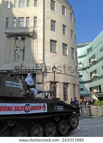 LONDON, UK - March 20, 2015:  The Stig on top of a tank outside BBC Broadcasting House delivering a petition in support of Top Gear presenter Jeremy Clarkson. - stock photo