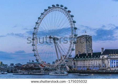 LONDON, UK - MARCH 17, 2013: View of the London Eye at evening. London Eye - a famous tourist attraction over river Thames in the capital city London.  - stock photo