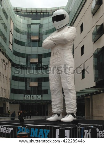 LONDON, UK - MAY 18, 2016: A giant statue of the Stig racing driver standing outside the BBC Broadcasting House headquarters in London to promote a new series of the motoring series Top Gear.