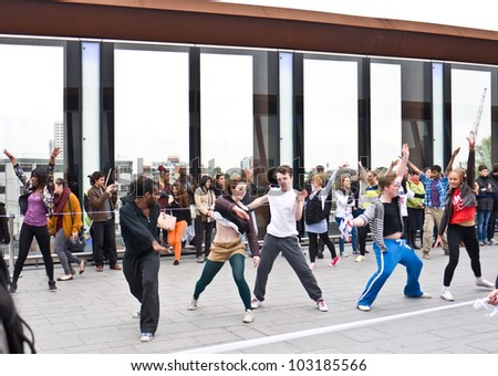 LONDON, UK- MAY 18:  Dancers from East London perform a flash dance near Westfield Stratford, to launch the annual Big dance festival. May 18, 2012 in London UK.